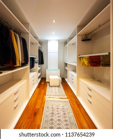 Walk-in closet with only male clothes. Nobody inside