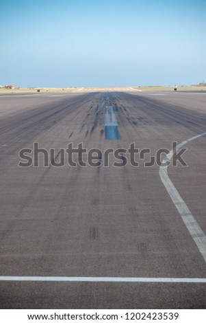 Walking across the runway at Gibraltar on Winston Churchil avenue which is closed when the runway is needed