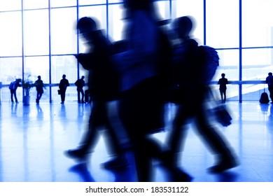 Walking airport travelers