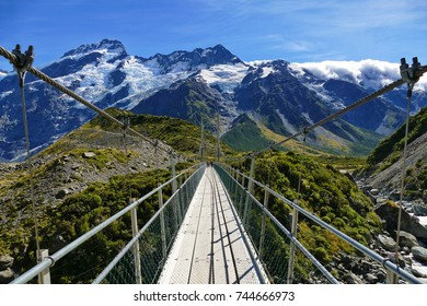 Walking along one of the many swing bridges at the Hooker Valley track, Mount Cook, New Zealand. (19-03-2017)