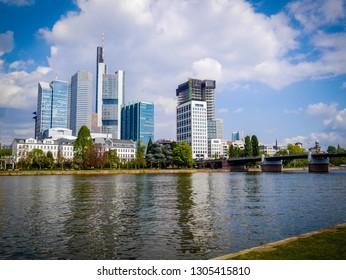 Walking along the riverbank opposite Stadel museum, Financial district in  Frankfurt GERMANY
