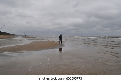walking along the seaside of the Baltic sea in jurmala, latvia in stormy day