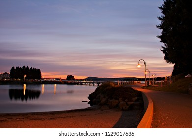 Walking along the waterfront at Maffeo Sutton Park in the city of Nanaimo, witnessing a gorgeous sunrise taking place over the calm waters of the inner harbor, peaceful and tranquility at its best.