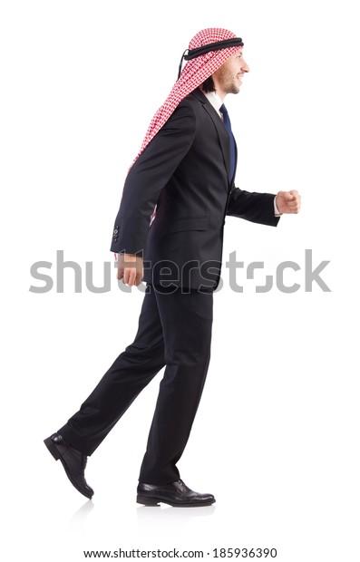 Walking arab man isolated on white