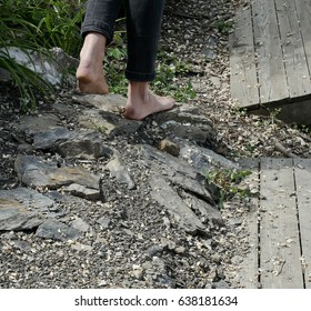 Walking barefoot on a path in the woods.