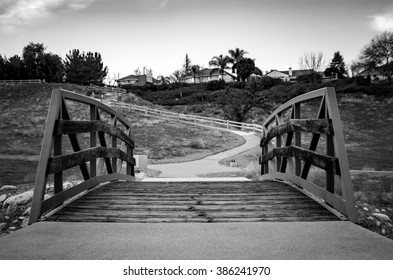 Walking bridge in black & white. Forward perspective, moody tone.