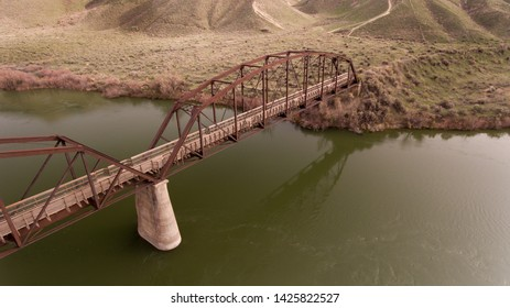 walking bridge going over a large river