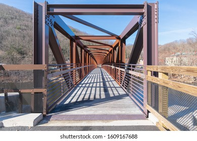 Walking bridge receding into distance