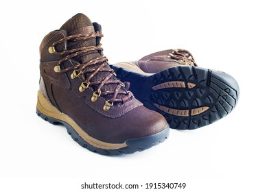 walking brown boots with sturdy soles on a white background