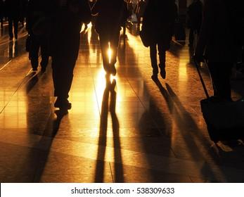 walking businessman in sunset light