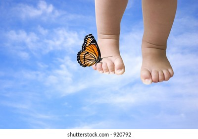 walking in the clouds ( baby feet with butterfly on a blue sky background, photoshop work)
