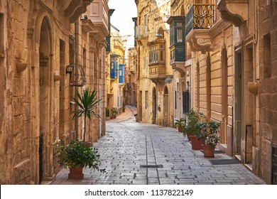 Walking cobblestone street in Birgu city, Malta