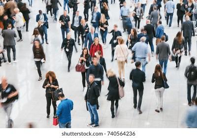 walking crowd of people at a fair floor