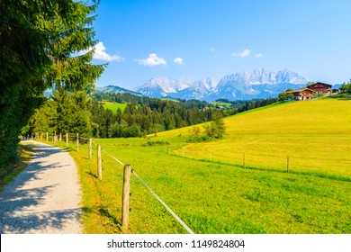 Walking and cycling route along green meadow in Gieringer Weiher mountain area, Kitzbuhel Alps, Austria