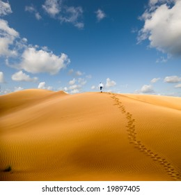 Walking in desert, conceptual; walking away from trouble
