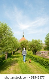 Walking the dog near the Old Dutch church
