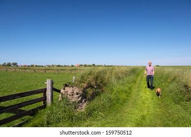Walking with dog on Dutch wadden island Texel