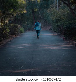 Walking down an empty path in a park in California.