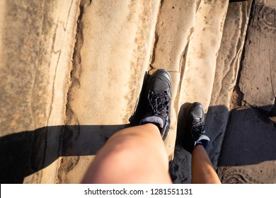 walking down on steep stairs,staircase