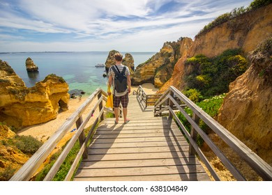 Walking down the stairs on the Camilo beach in Lagos, Algarve