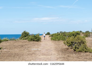 Walking in a dried landscape along the coast of the Baltic Sea at the swedish island Oland