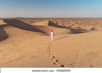 Walking in the dubai desert dunes with foot steps in the sand, Duba February 2017