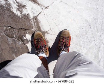 Walking with feet resting on a white marble slab