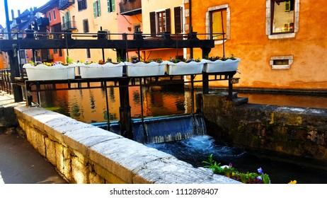 walking as following waterway in Annecy, France.