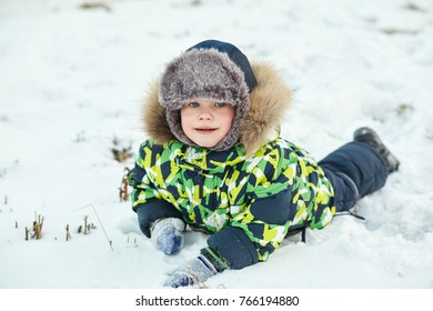walking funny little boy in the winter. child outdoors