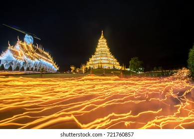 Walking with lighted candles in hand around a temple candles light trail and paper lantern of yeepeng festival of pagoda at Hyua Pla Kang Temple on Visakha Buja Day Thailand