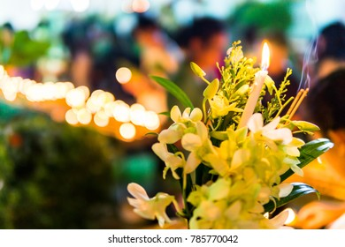 walking with lighted candles in hand around a temple