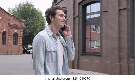 Walking Man Discussing on Phone Call