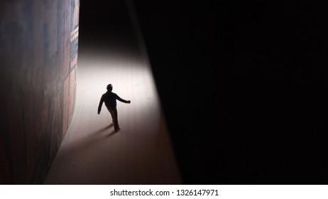 Walking Mini Figure to at Tunnel Through Bright Future