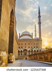 Walking the narrow medieval streets of Saladin Citadel with a view on stone walls and the great Alabaster Mosque with tall minarets, Cairo, Egypt.