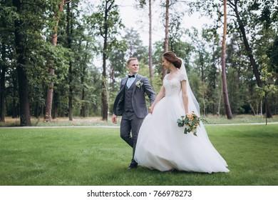 Walking newlyweds in nature.