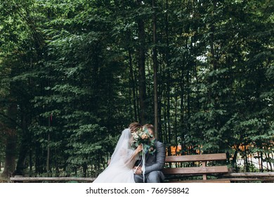Walking newlyweds in nature. Meeting on the bench.