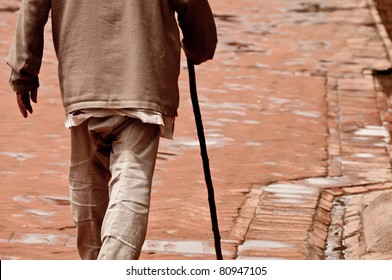 Walking old man with a stick