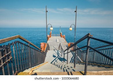 walking on a concrete pier in Miedzyzdroje. Town and a seaside resort in Poland on the island of Wolin