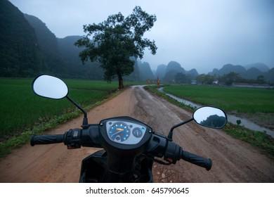 Walking on a rented motorcycle or motorbike in Asia