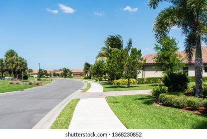 Walking on the sidewalk in a residential golf community in South Florida.