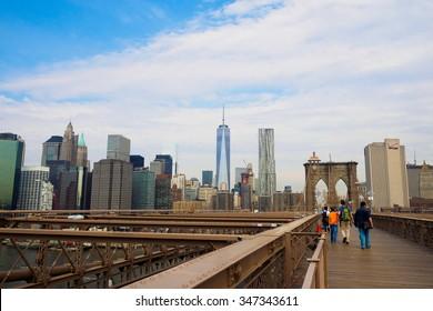 walking over Brooklyn Bridge, New York USA