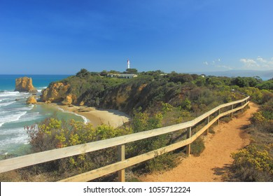 Walking path along the cliff edge at Split Point foreshore with its iconic 1891 lighthouse in Aireys Inlet which along the route of the Great Ocean Road, Australia.