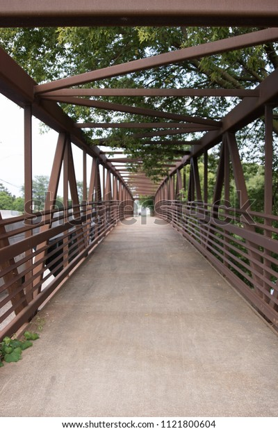 Walking path bridge that goes over a river.