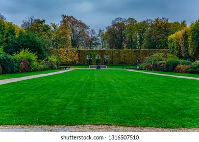 Walking path on autumn and beautiful grass at the park in Paris, France.