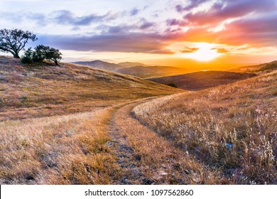 Walking path on the grassy hills of south San Francisco bay area at sunset, San Jose, California