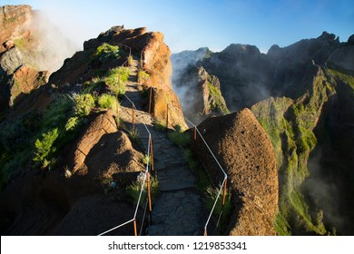 walking path over the volcanic mountain ridge with an abyss on both sides
