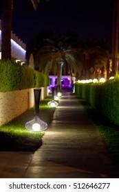 Walking paths with night illumination on territory hotel.