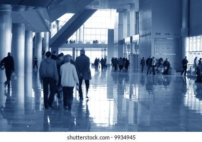 walking people inside modern building