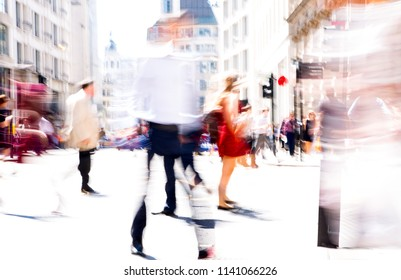 Walking people motion blur. City of London busy business life. People crossing the road