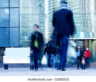 walking people rushing on the street in intentional motion blur
